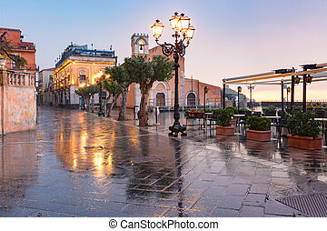 Belvedere of Taormina on the square Piazza IX Aprile in Taormina at rainy night, Sicily, Italy