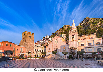 Morning square Piazza IX Aprile with San Giuseppe church and the Clock Tower, Taormina, Sicily, Italy