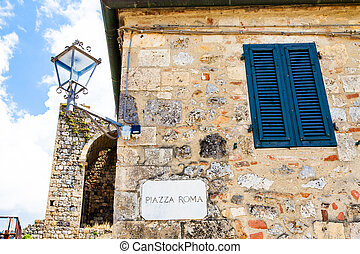 Piazza Roma - Monteriggioni, Tuscany, Italy. Street plate of...