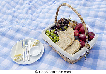 Pic-nic basket with fruit and dish on blue seamless plaid pattern