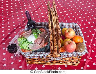 Pic-nic basket with salad and fruits