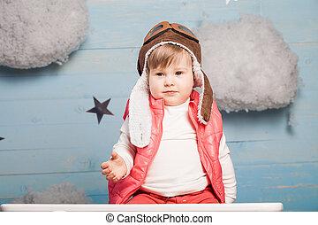 piccola ragazza, seduta, in, giocattolo legno, aereo