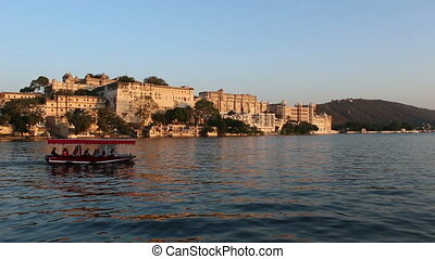 Pichola lake and palaces in Udaipur India at evening