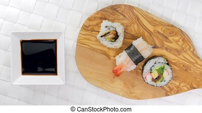 Pick and dip chicken sushi in soy sauce - Caucasian male...