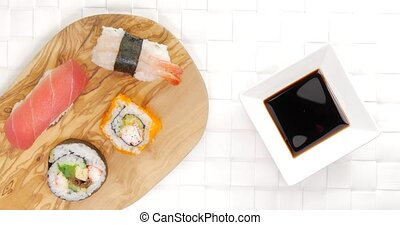 Pick and dip crab sushi in soy sauce - Caucasian male...