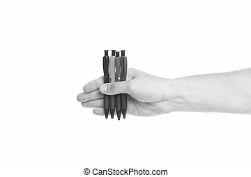Pick one. Male hand hold four pens isolated white background...