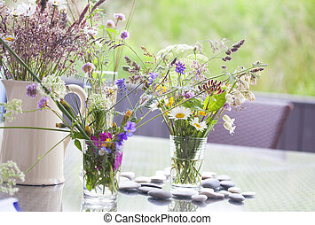 picked wild flowers with colorful flowers in a vase and...