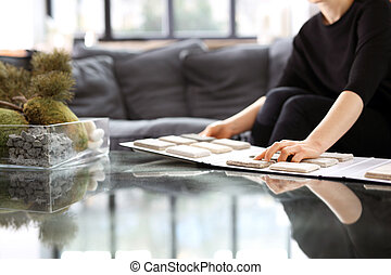 Picker carpet. - Woman in shop with carpets chooses carpet ...