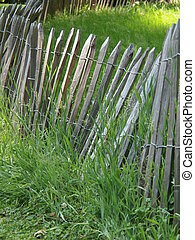 Picket fence - Old wooden picket fence in the field