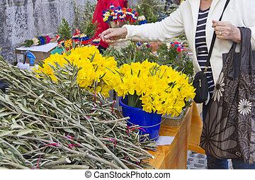 Picking flowers on market
