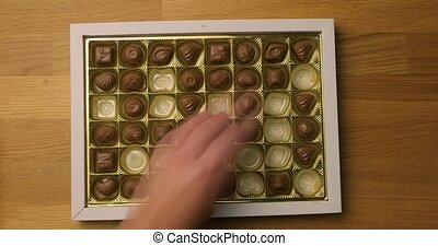 Box of chocolate bonbon hand pickink pieces fast