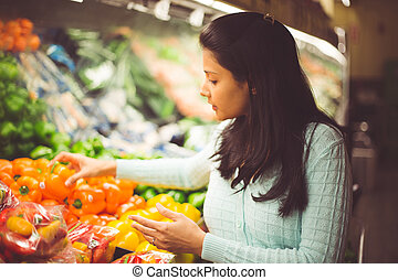 Picking the right vegetable - Closeup portrait, young woman...