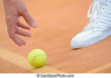 picking up a ball
