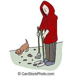 An image of man picking up dog poop.
