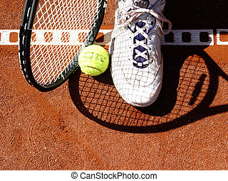 picking up - on the tennis court: racket, ball and shoe