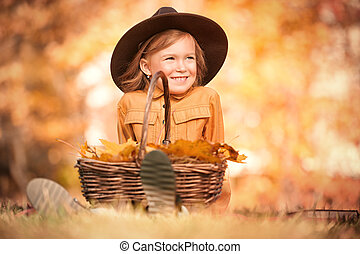 picking up the autumn herbarium - Autumn. Little girl ...