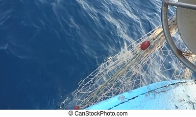 Picking up the nets on fishing boat