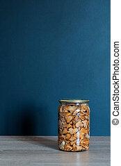 Pickled chanterelles mushrooms in jar