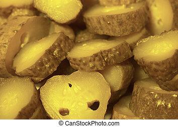 Close up background - sliced pickled cucumbers - cornichons