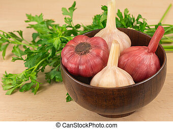 pickled garlic in a wooden bowl
