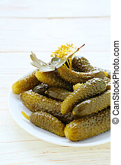 pickled gherkins on a plate, food closeup
