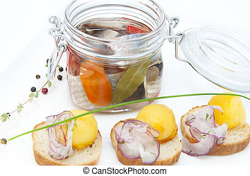 Pickled herring in a glass jar