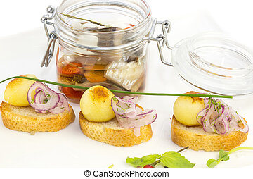 pickled herring in a glass jar with