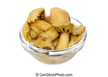 pickled mushrooms in glass bowl isolated on white