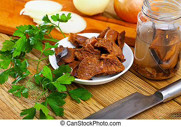 Pickled mushrooms with parsley