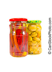 pickled musroom and peppers in glass pots isolated on white
