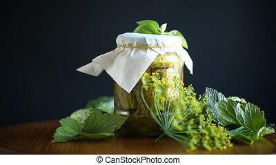 Pickled pickled cucumbers in a glass jar