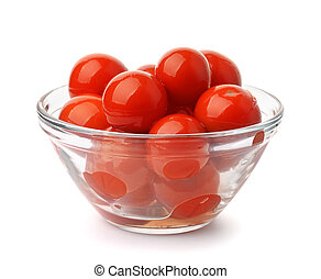 Pickled tomatoes in glass bowl