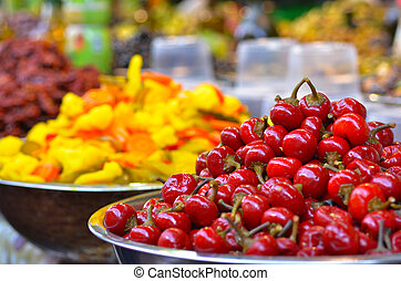 Pickled tomatoes on display in food market