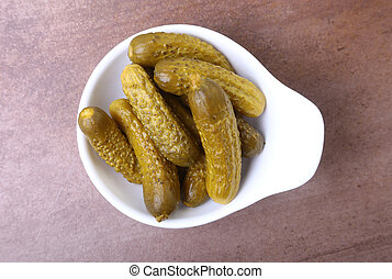 Pickles. Bowl of pickled gherkins cucumber with copy space. Cornichons