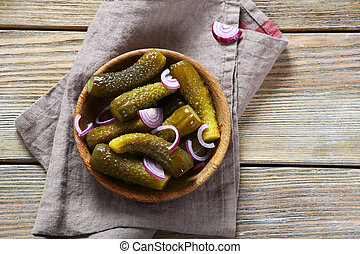 Pickles in wooden bowl