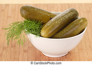 Pickled cucumbers with dill in a bowl