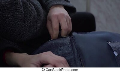 Pickpocket stealing phone from a woman's handbag in tram or bus