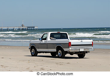 Pickup truck driving on the beach in the southern Texas, USA