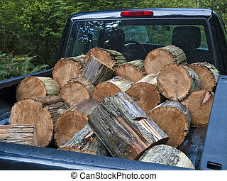Pickup truck filled with firewood - Pickup truck loaded with...