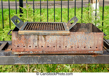 Picnic area with barbecue grill. Barbecue close-up. Country holidays