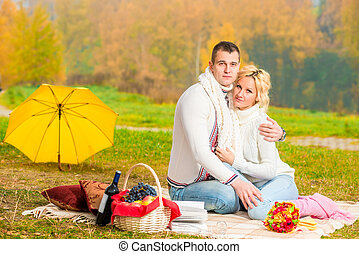 picnic autumn day. happy couple relaxing