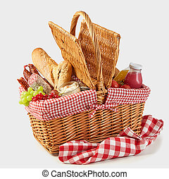 Picnic basket packed with a tasty summer lunch