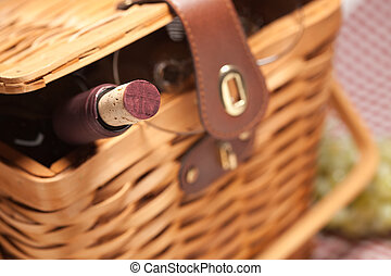 Picnic Basket, Wine Bottle and Empty Glasses on a Gingham...