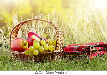 Picnic basket with blanket - Picnic basket with fruits....