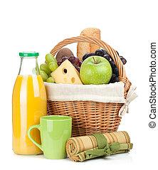 Picnic basket with bread, fruits and orange juice bottle....