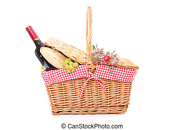 picnic basket with bread, grapes and wine