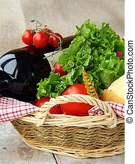 picnic basket with fresh vegetables
