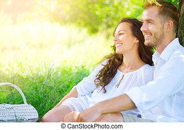 Picnic. Beautiful young couple having romantic dinner...