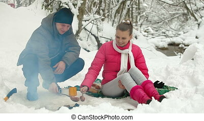 Picnic By The Campfire In Winter