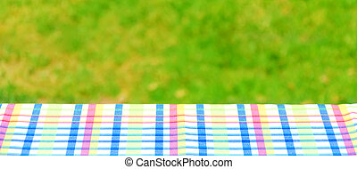 Picnic colorful tablecloth on the table